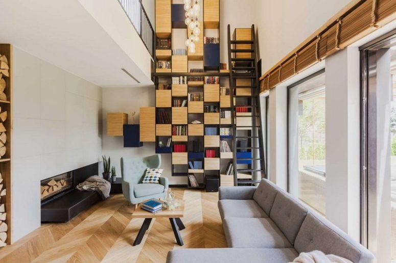 别致的现代公寓室内装饰着大胆的蓝色风采