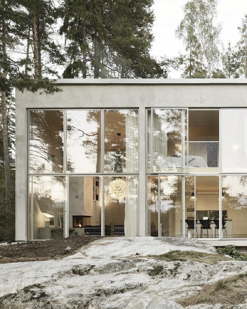 一所隐藏在树林中的休闲居所简约室内装饰设计